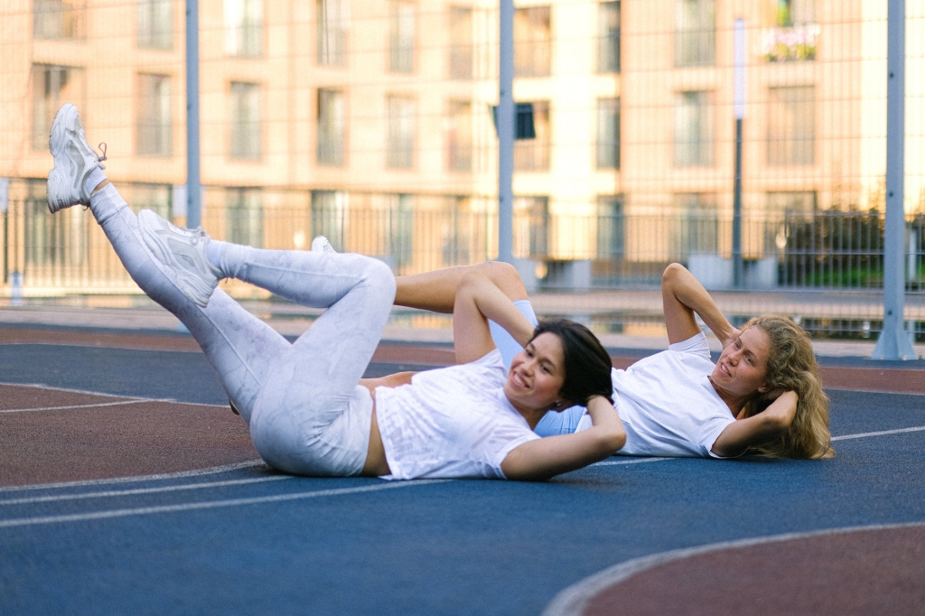 Women doing bicycle crunches