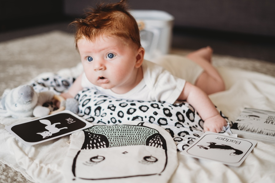 A baby with black and white sensory toys